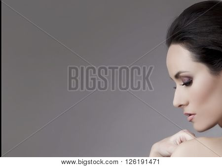 Studio Portrait Of Young Beautiful Brunette Woman. Close Up