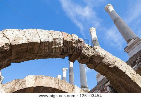 Ancient White Columns And Arches Over Blue Sky
