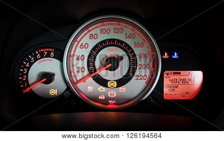 Modern car illuminated dashboard closeup, car, syringe, dashboard,