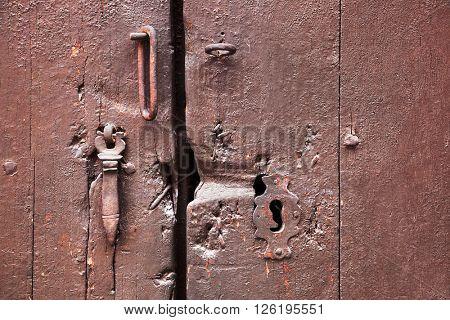 painted wooden door with a keyhole