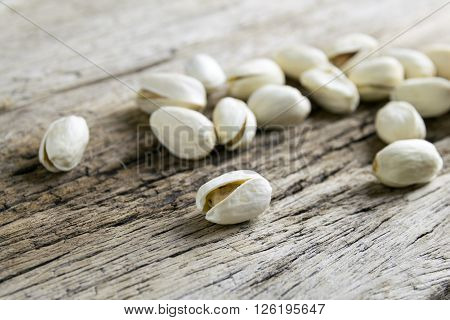 Pistachio nuts on wood background, pistachio, brown, burlap,