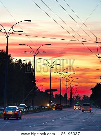 Trafic On Highway At Sunset