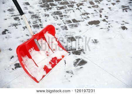 Red plastic shovel for snow