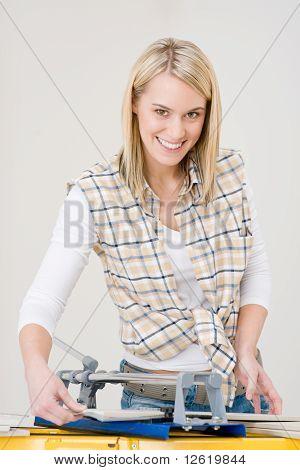 Home Improvement - Handywoman Cutting Tile