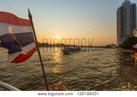 BANGKOK, THAILAND - JAN 23, 2016: â?ªLocal transport boat on â?ªChao Phraya river. More than 15 boat-lines operate on the rivers and canals of the city, including commuter lines, fares: by 8-40 Baht.