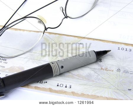 Glasses, Pen, And Checkbook