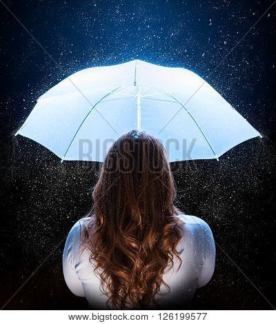 blonde woman with white umbrella under stardust