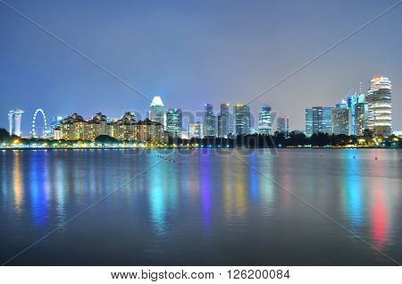 Singapore downtown skyline with colourful reflections at Kallang River by night