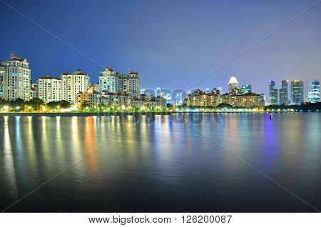 Residential buildings with colourful reflections at Kallang River (South of Singapore) by night ** Note: Visible grain at 100%, best at smaller sizes