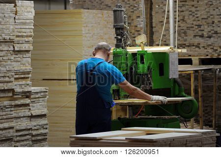 A Carpenter Works On Woodworking The Machine Tool.