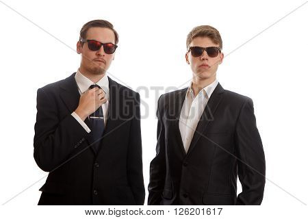 Two well dressed young adults on white background