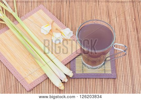 Thai herbal drinks Lemon grass water wooden floor background
