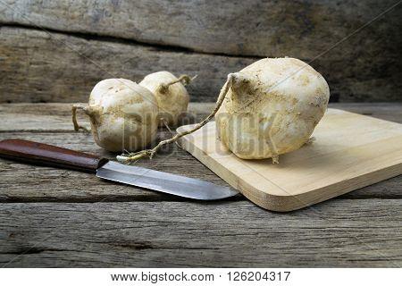 jicama on grunge wooden background, delicious, whole, tuber, white,