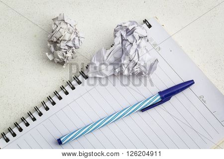 Book a loop line. A blue pen placed on top. And scraps of paper left Maul