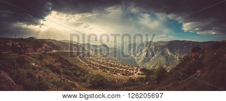 Beautiful landscape with green mountains and magnificent cloudy sky in sunset. Exploring Armenia