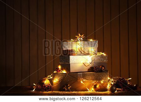 Gift boxes and Christmas decor on wall background