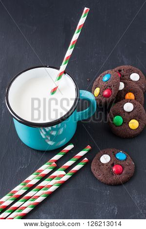 chocolate cookies and milk on a black background