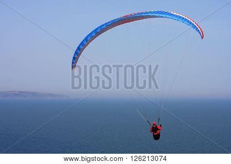 Paraglider flying above Start Bay in Devon