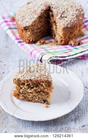 carrot and walnut cake on a white wooden background