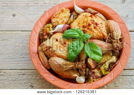 Two Small Whole Chicken Baked With Onions, Apples, Garlic And Spices In A Clay Form