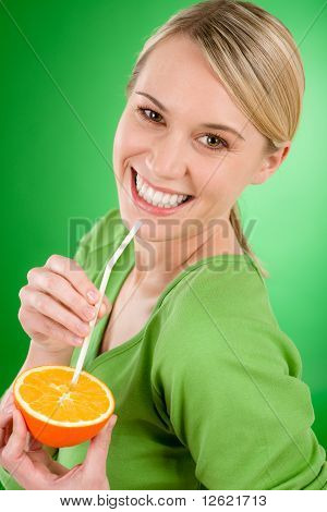 Healthy Lifestyle - Woman Drink Juice From Orange With Straw