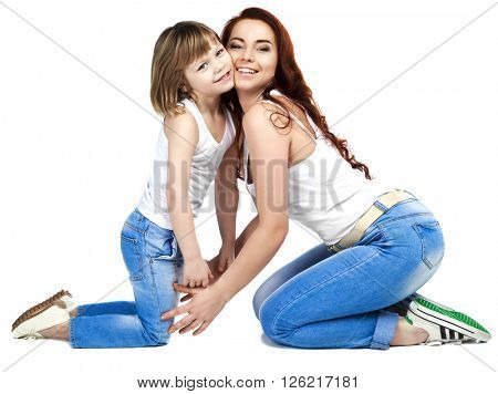 happy laughing mother and her son on the floor, isolated against white studio background