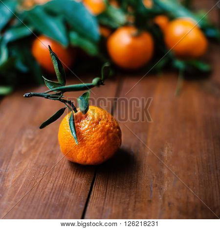 Juicy orange tangerines on a old wooden table