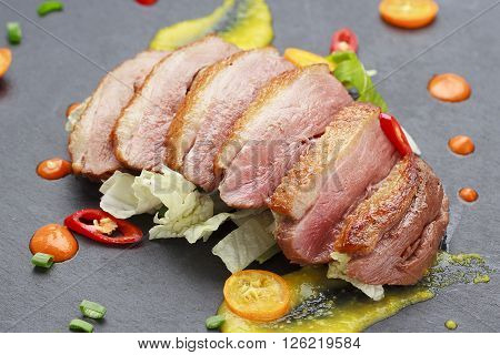Pekin duck with vegetables over black background