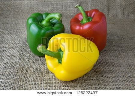 Colored bell peppers on wooden table,pepper, bell, colourful