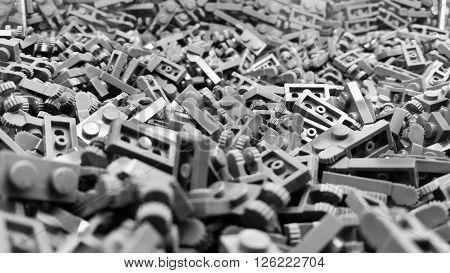 Many grey plastic toy blocks arranged together