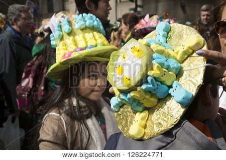 NEW YORK - MAR 27 2016: Kids wearing decorative Easter bonnets made of marshmallow peeps candy on 5th Avenue on Easter Sunday for the traditional Easter Bonnet Parade in Manhattan on March 27, 2016.