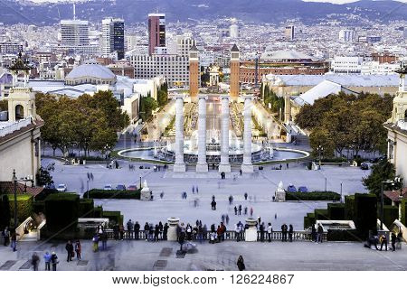 BARCELONA SPAIN - NOVEMBER 20 2015: Tourist people around the Four Columns which is on the place in front of National Art Museum of Catalonia near plaza de espana Barcelona Spain. Zoomed shot.