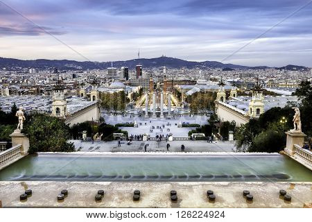 BARCELONA SPAIN - NOVEMBER 20 2015: Tourist people around the Four Columns which is on the place in front of National Art Museum of Catalonia near plaza de espana Barcelona Spain.