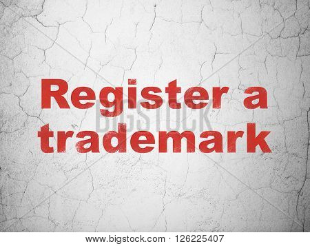 Law concept: Register A Trademark on wall background