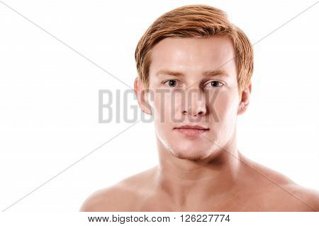 Portrait of a beautiful friendly young blond man.