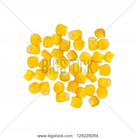 Ripe corn isolated. A few grains of canned corn on a white background. Sweet whole kernel corn