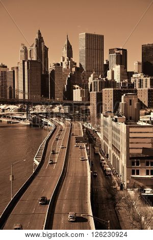 Manhattan financial district with skyscrapers and highway over East River.