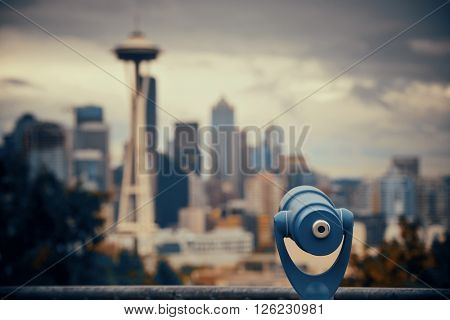 Seattle city view from Kerry Park with urban architecture and telescope.