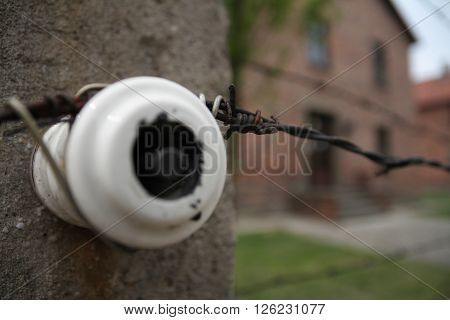 Oswiecim, Poland - May 09, 2015: Closeup View Of Electric Fence In Former Nazi Concentration Camp Au
