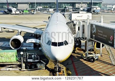 BRUSSELS BELGIUM - MARCH 17: Airplanes on the boarding gates of Zaventem International Airport on March 17 2016 in Brussels.
