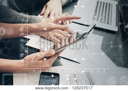 Photo female hands holding modern tablet and touching screen.Businessmans crew working new investment project  office.Using electronic devices. Graphics icons, stock exchanges interface.