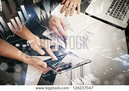 Photo female hands holding modern tablet and touching screen.Businessmans team working new investment project  office.Using electronic devices. Graphics icons, stock exchanges interface.