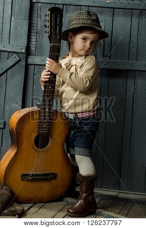 Baby Girl With Acoustic Guitar
