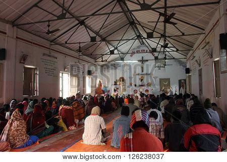 BAIDYAPUR, INDIA - DECEMBER 02: Mass in the Catholic Church in Baidyapur, West Bengal, India on December 02, 2012.