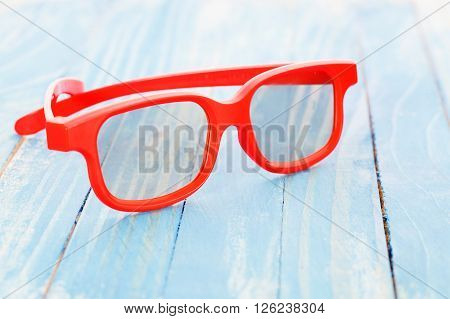 Protective glasses on a blue painted table