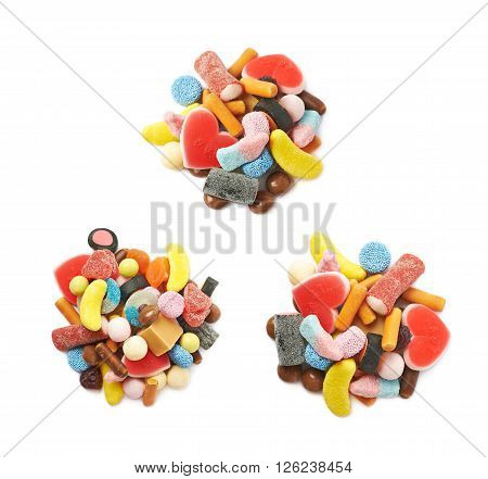 Pile of multiple different colorful candies isolated over the white background, set of three different foreshortenings