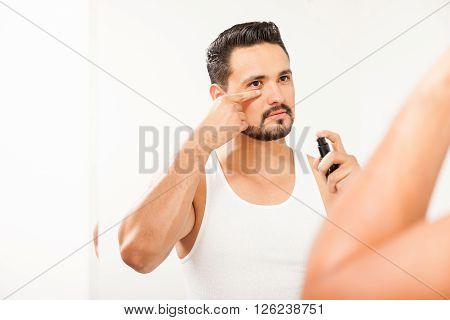 Attractive Man Using Anti-aging Cream