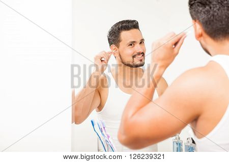 Hispanic Young Man Using A Cotton Swab