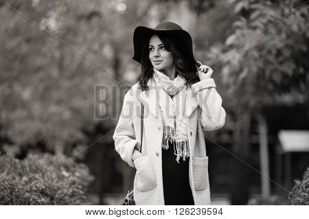 Beautiful girl in autumn garden. Black and white photography
