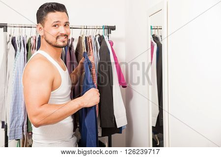 Good Looking Guy Getting Dressed At Home